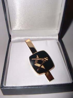 black and gold cufflinks and tie bar
